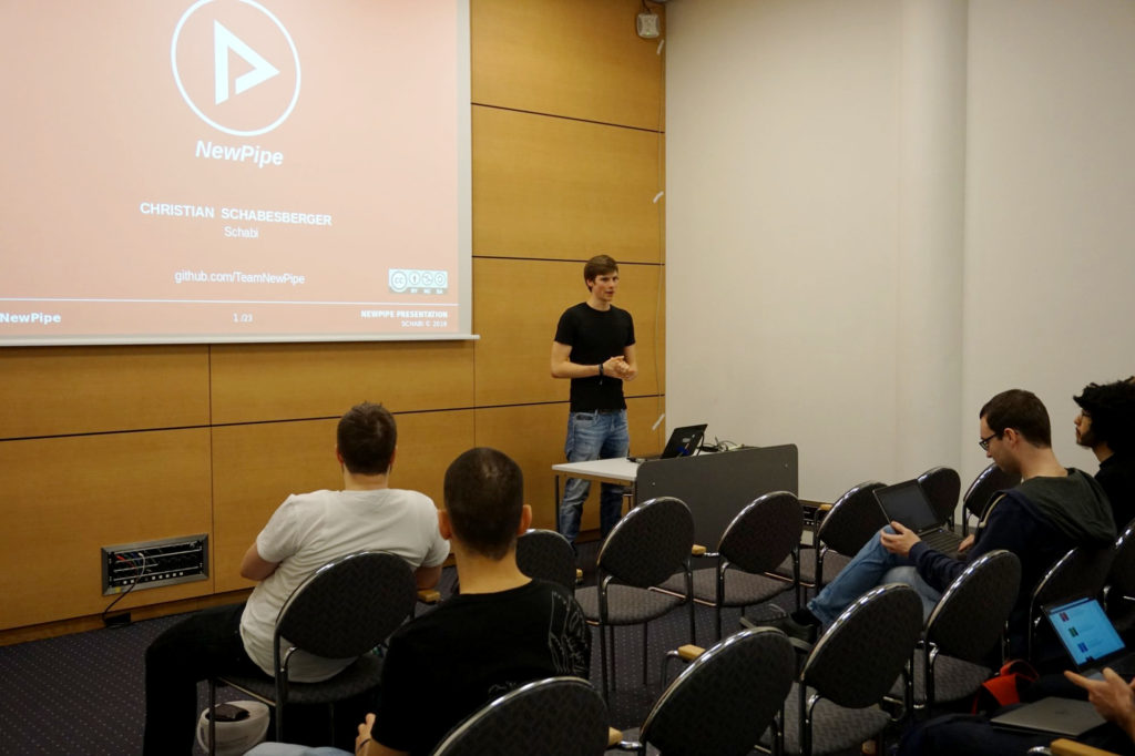 Schabi giving a talk about NewPipe